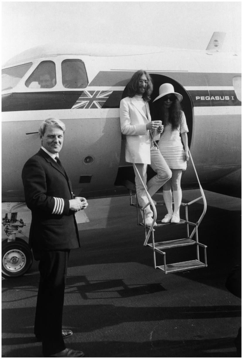 john-lennon-and-yoko-ono-both-dressed-in-white-board-a-private-aircraft-in-gibraltar-after-their-wedding-20th-march-1969